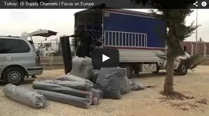 """la primera cadena nacional en Occidente en reconocer que el llamado """"Estado Islámico"""" se suministra no por el """"mercado negro del petróleo"""" o por el """"rescates de rehenes"""", sino a través de miles de millones de dólares del valor de los suministros realizados en Siria a través de las fronteras de un miembro de la OTAN: Turquía, a través de la que entran y salen cientos de camiones al día."""
