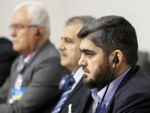 """Mohammed Aluche, negociador principal de la """"oposición moderada"""" en las negociaciones de Ginebra, llegó a esa responsabilidad arrojando homosexuales de los techos de Duma, localidad cercana a Damasco."""